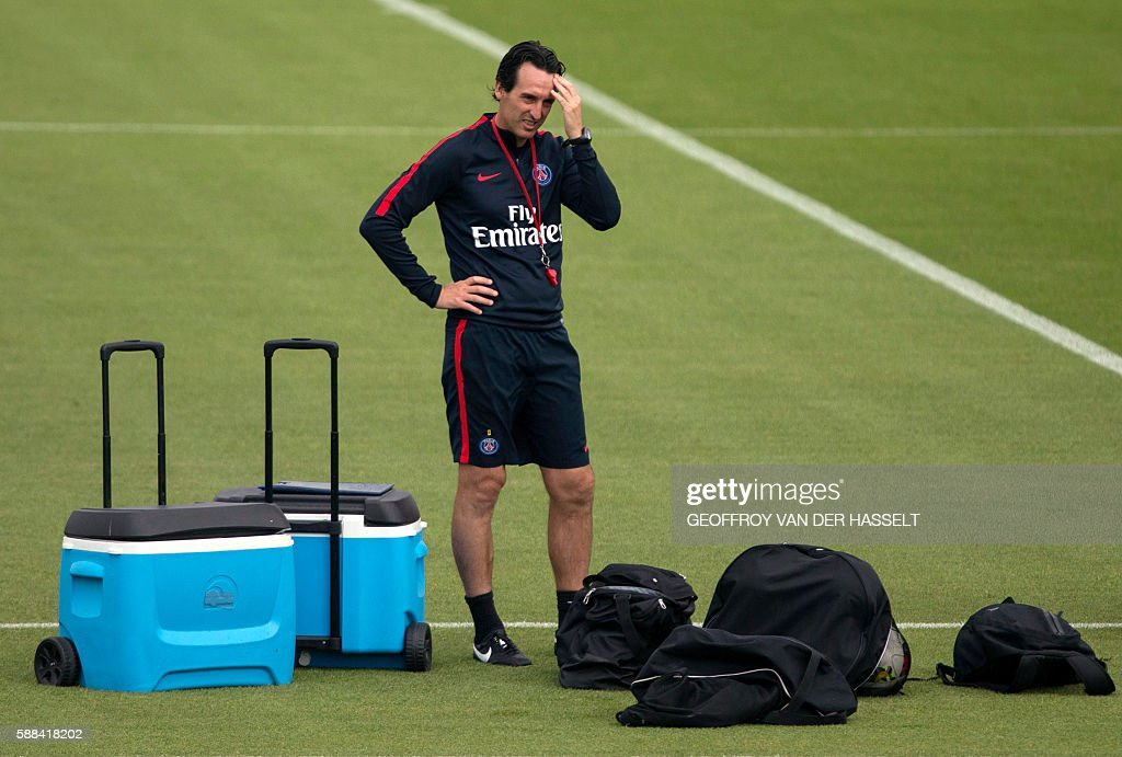 Paris SaintGermain's Spanish headcoach Unai Emery attends a training session at the Camp des Loges training centre in SaintGermainenLaye west of...