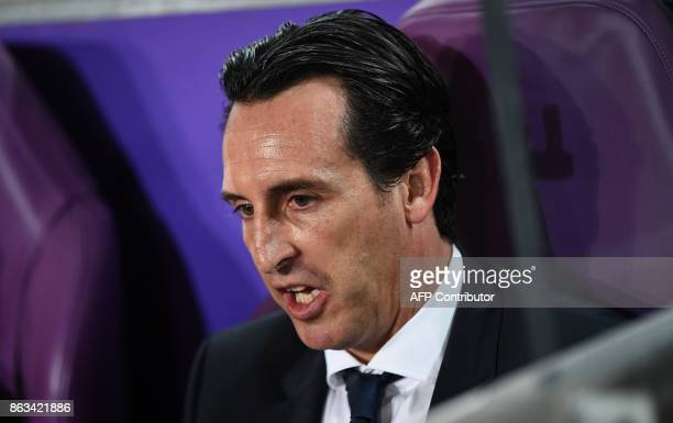 Paris SaintGermain's Spanish headcoach Unai Emery reacts on the bench during the UEFA Champions League Group B football match between RSC Anderlecht...
