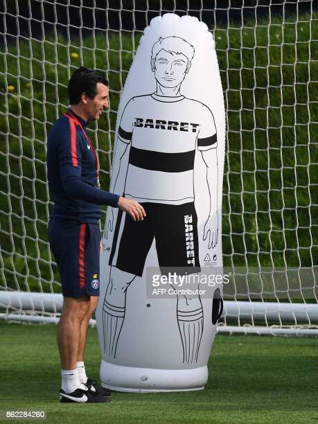 Paris SaintGermain's Spanish headcoach Unai Emery takes part in a training session at SaintGermainenLaye western Paris on October 17 on the eve of...