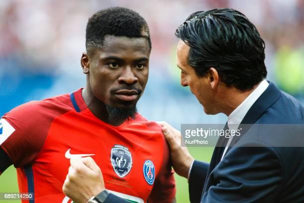 Paris SaintGermain's Spanish headcoach Unai Emery talks with Paris SaintGermain's Ivorian defender Serge Aurier prior to the French Cup final...