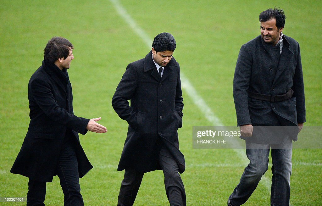 Paris Saint-Germain's sporting director Brazilian Leonardo, Chairman of the Paris Saint-Germain L1 football club, Nasser Al-Khelaifi (L) of Qatar speak with Qatari Crown Prince and PSG owner Tamim bin Hamad Al-Thani during a training session on January 30, 2013 at the Camp des Loges in Saint-Germain-en-Laye, west of Paris. AFP PHOTO / FRANCK FIFE