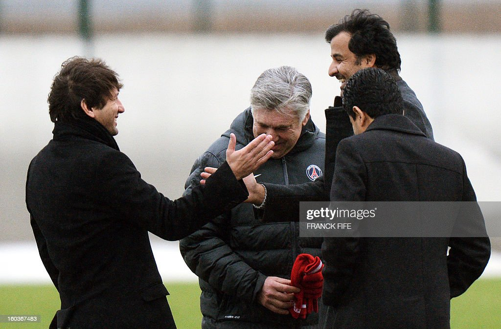 Paris Saint-Germain's sporting director Brazilian Leonardo, Paris Saint-Germain's coach Carlo Ancelotti, Chairman of the Paris Saint-Germain L1 football club, Nasser Al-Khelaifi (L) of Qatar speak with Qatari Crown Prince and PSG owner Tamim bin Hamad Al-Thani during a training session on January 30, 2013 at the Camp des Loges in Saint-Germain-en-Laye, west of Paris. AFP PHOTO / FRANCK FIFE
