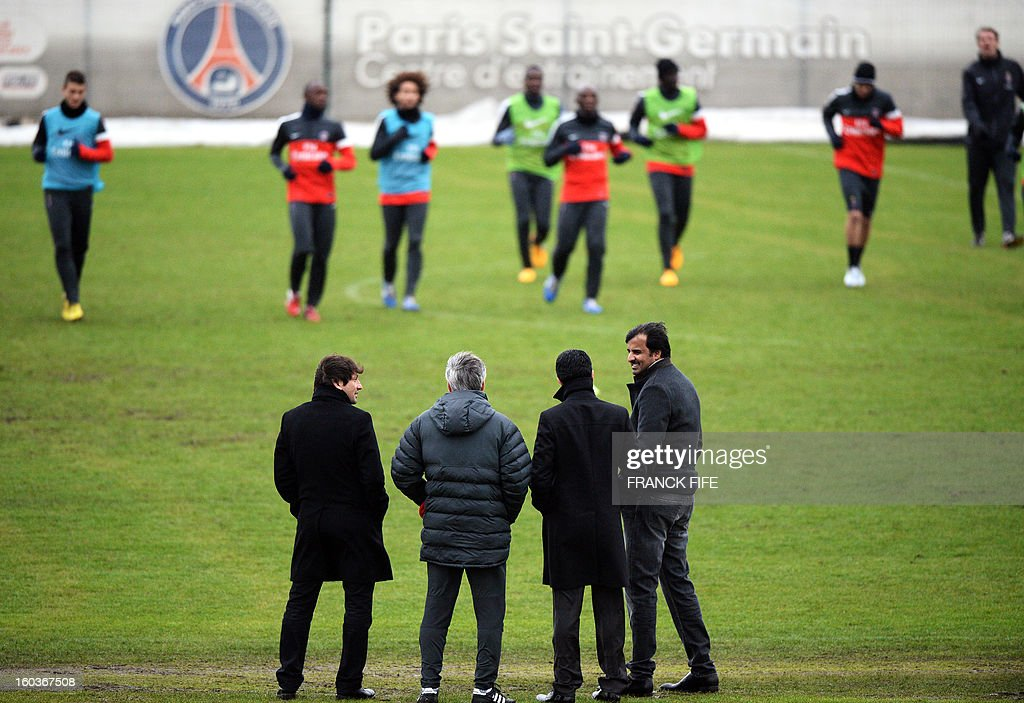 Paris Saint-Germain's sporting director Brazilian Leonardo, Paris Saint-Germain's coach Carlo Ancelotti Chairman of the Paris Saint-Germain L1 football club, Nasser Al-Khelaifi (L) of Qatar and Qatari Crown Prince and PSG owner Tamim bin Hamad Al-Thani look as his players during a training session on January 30, 2013 at the Camp des Loges in Saint-Germain-en-Laye, west of Paris. AFP PHOTO / FRANCK FIFE