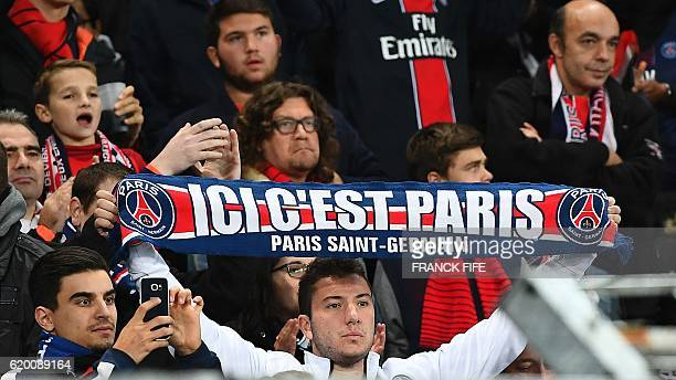 A Paris SaintGermain's supporter holds a scarf prior to the UEFA Champions League group A football match between FC Basel and Paris SaintGermain on...
