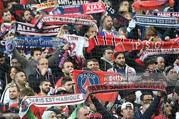 Paris SaintGermain's supporters brandish scarves before the French L1 football match between Marseille and Paris on April 5 2015 at the Velodrome...