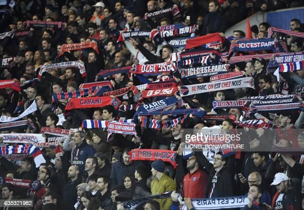 Paris SaintGermain's supporters cheer during the UEFA Champions League round of 16 first leg football match between Paris SaintGermain and FC...