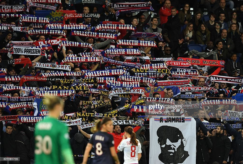 Paris Saint-Germain's supporters cheer during the UEFA Women's Champions League semi-final second leg football match between Paris Saint-Germain (PSG) and Lyon at the Parc des Princes stadium in Paris on May 2, 2016. / AFP / FRANCK