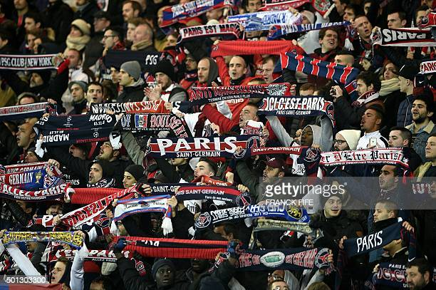 Paris SaintGermain's supporters hold their club's scarves during the French Ligue 1 football match between Paris SaintGermain and Olympique Lyonnais...