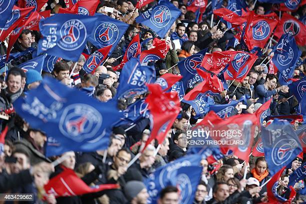 Paris SaintGermain's supporters wave flags and cheer on their team during the French L1 football match Paris SaintGermain vs Caen at the Parc des...