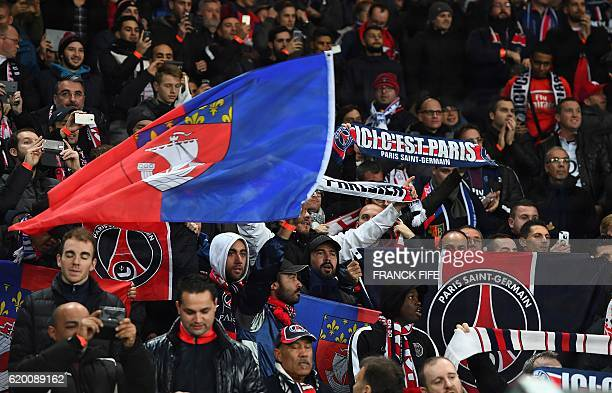 Paris SaintGermain's supporters wave flags and scarves prior to the UEFA Champions League group A football match between FC Basel and Paris...
