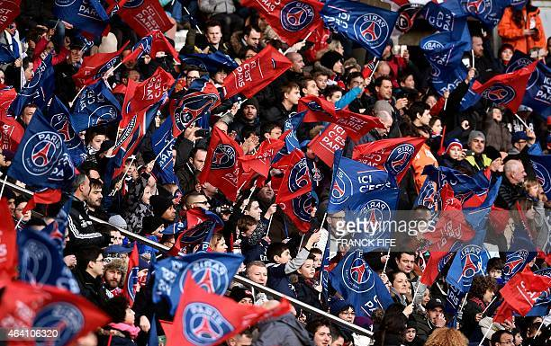 Paris SaintGermain's supporters wave flags during the French L1 football match between Paris SaintGermain vs Toulouse on February 21 2015 at the Parc...