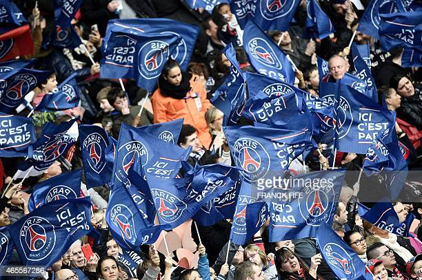 Paris SaintGermain's supporters wave flags during the French L1 football match between Paris SaintGermain and Lens on March 7 2015 at the Parc des...