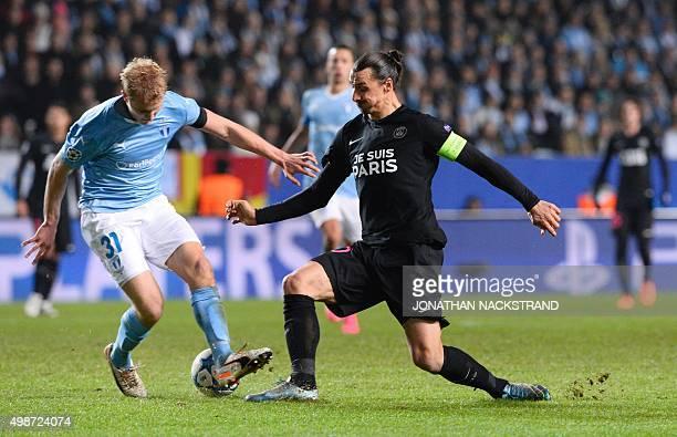 Paris SaintGermain's Swedish forward Zlatan Ibrahimovic and Malmo FF's defender Franz Brorsson vie for the ball during the UEFA Champions League...