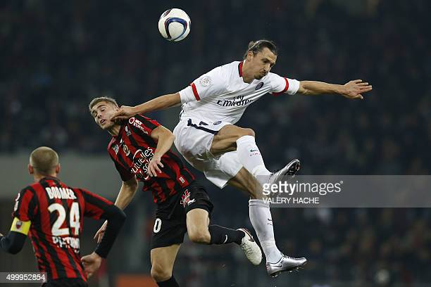 Paris SaintGermain's Swedish forward Zlatan Ibrahimovic and Nice's French defender Maxime Le Marchand go for a header during the French L1 football...