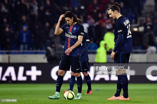 Paris SaintGermain's Swedish forward Zlatan Ibrahimovic and Paris SaintGermain's Uruguayan forward Edinson Cavani react after Lyon scored a second...