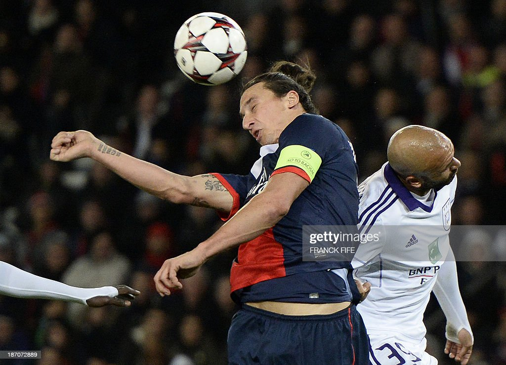 Paris Saint-Germain's Swedish forward Zlatan Ibrahimovic (L) and Anderlecht's midfielder Samy Bourard jump for the ball during the UEFA Champions League football match Paris Saint-Germain (PSG) vs RSC Anderlecht (RSCA) on November 5, 2013 at the Parc des Princes in Paris. The match ended in a draw 1-1 the Paris goal scored by Ibrahimovic. AFP PHOTO / FRANCK FIFE