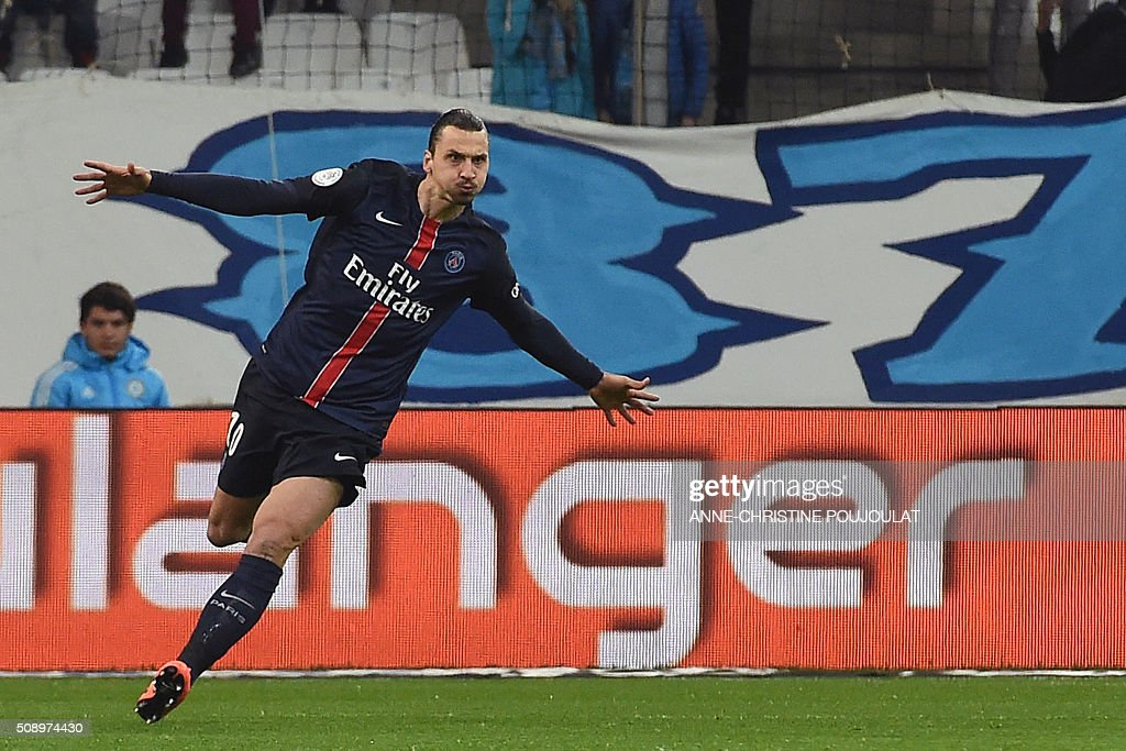 Paris Saint-Germain's Swedish forward <a gi-track='captionPersonalityLinkClicked' href=/galleries/search?phrase=Zlatan+Ibrahimovic&family=editorial&specificpeople=206139 ng-click='$event.stopPropagation()'>Zlatan Ibrahimovic</a> celebrates after scoring a goal during the French L1 football match between Marseille and Paris-Saint-Germain on February 7, 2015 at the Velodrome stadium in Marseille, southern France.