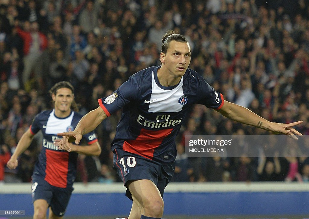 Paris Saint-Germain's Swedish forward <a gi-track='captionPersonalityLinkClicked' href=/galleries/search?phrase=Zlatan+Ibrahimovic&family=editorial&specificpeople=206139 ng-click='$event.stopPropagation()'>Zlatan Ibrahimovic</a> celebrates after scoring the opening goal during the French L1 football match between Paris Saint-Germain and AS Monaco at the Parc des Princes Stadium in Paris on September 22, 2013.