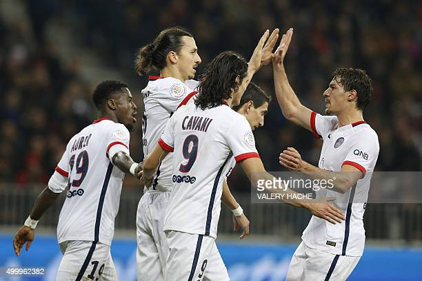 Paris SaintGermain's Swedish forward Zlatan Ibrahimovic celebrates with his teammates after scoring a penalty during the French L1 football match...