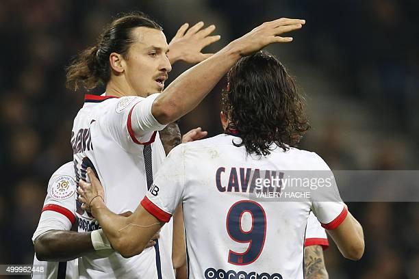 Paris SaintGermain's Swedish forward Zlatan Ibrahimovic celebrates with Paris SaintGermain's Uruguayan forward Edinson Cavani after scoring a penalty...
