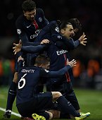 Paris SaintGermain's Swedish forward Zlatan Ibrahimovic celebrates with teammates after scoring a goal during the Champions League round of 16 first...
