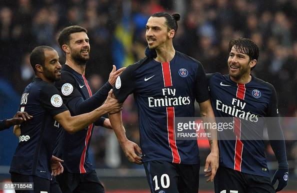 Paris SaintGermain's Swedish forward Zlatan Ibrahimovic celebrates with his teammates after scoring during the French L1 football match between Paris...