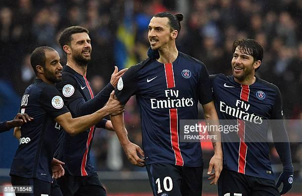 Paris SaintGermain's Swedish forward Zlatan Ibrahimovic celebrates with his teammates after scoring during the French L1 football match between Paris...