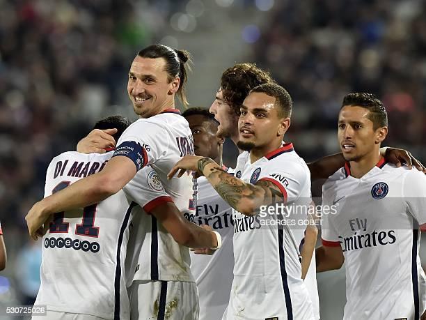 Paris SaintGermain's Swedish forward Zlatan Ibrahimovic celebrates with teammates after scoring a goal during the French L1 football match between...