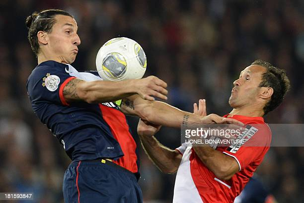 Paris SaintGermain's Swedish forward Zlatan Ibrahimovic challenges Monaco's Portuguese defender Ricardo Carvalho during the French L1 football match...