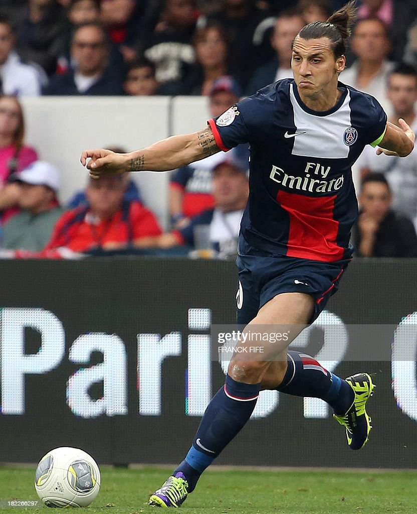 Paris Saint-Germain's Swedish forward <a gi-track='captionPersonalityLinkClicked' href=/galleries/search?phrase=Zlatan+Ibrahimovic&family=editorial&specificpeople=206139 ng-click='$event.stopPropagation()'>Zlatan Ibrahimovic</a> controls the ball during the French L1 football match between Paris Saint-Germain and Toulouse on September 27, 2013 at the Parc des Princes Stadium in Paris.