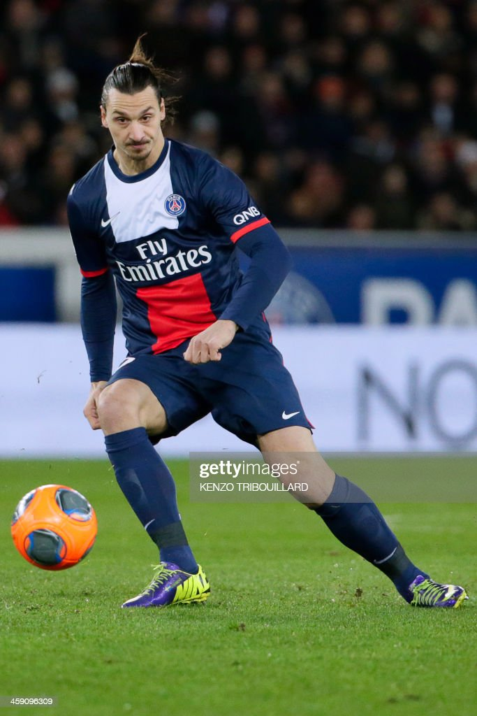 Paris Saint-Germain's Swedish forward Zlatan Ibrahimovic eyes the ball during the French L1 football match between Paris Saint-Germain (PSG) and Lille (LOSC) in Paris on December 22, 2013.