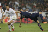Paris SaintGermain's Swedish forward Zlatan Ibrahimovic falls down as he vies with Ajaccio's defender Grendy Perozo during the French L1 football...