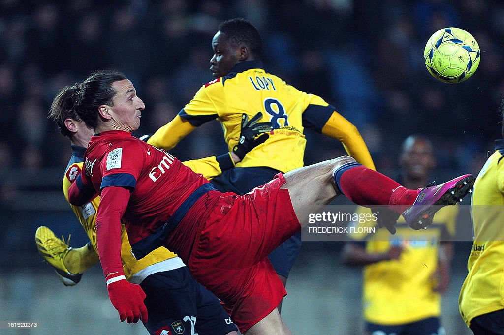 Paris Saint-Germain's Swedish forward Zlatan Ibrahimovic (L) fights for the ball with Sochaux' Senegalese midfielder Joseph Lopy on February 17, 2013 during a French L1 football match against Sochaux at the Auguste Bonal stadium in the eastern French city of Montbeliard. AFP PHOTO/FREDERICK FLORIN