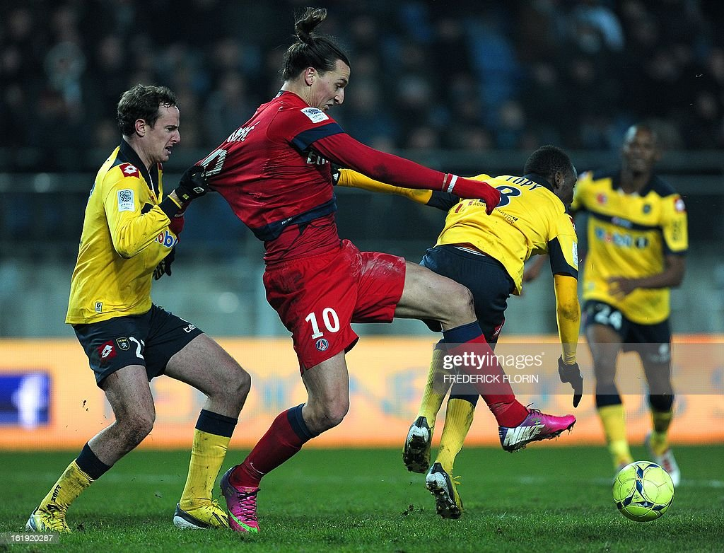 Paris Saint-Germain's Swedish forward Zlatan Ibrahimovic (R) fights for the ball with Sochaux French midfielder Vincent Nogueira on February 17, 2013 during a French L1 football match at the Auguste Bonal stadium in the eastern French city of Montbeliard.