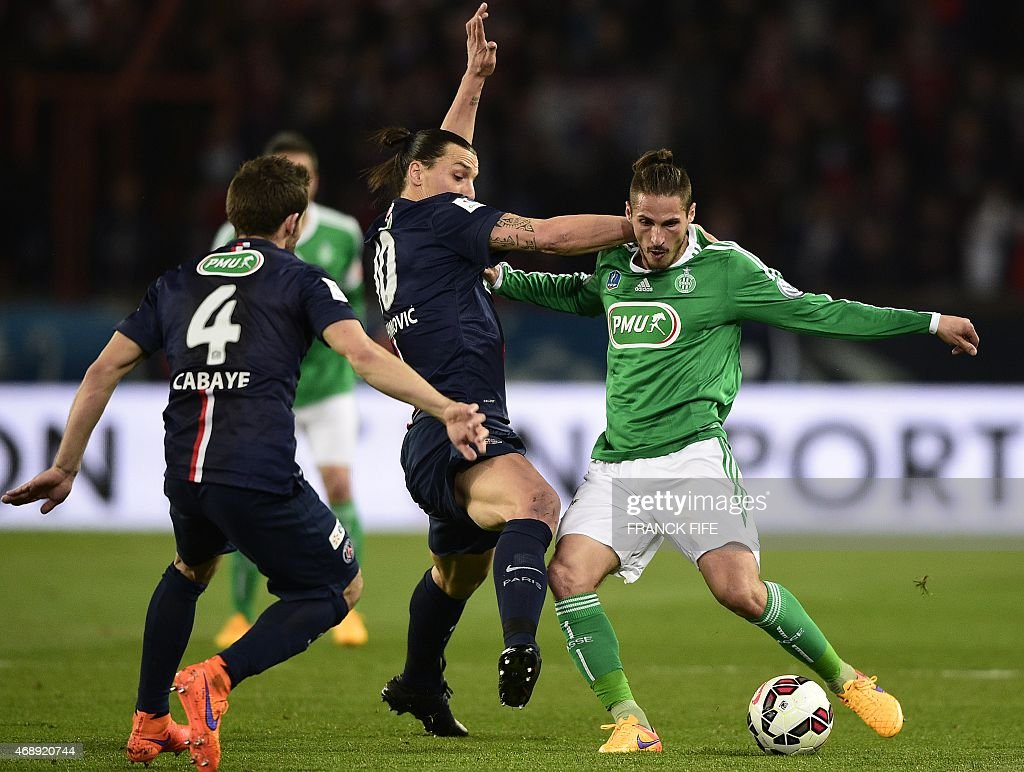Paris Saint-Germain's Swedish forward <a gi-track='captionPersonalityLinkClicked' href=/galleries/search?phrase=Zlatan+Ibrahimovic&family=editorial&specificpeople=206139 ng-click='$event.stopPropagation()'>Zlatan Ibrahimovic</a> (C) fights for the ball with Saint-Etienne midfielder <a gi-track='captionPersonalityLinkClicked' href=/galleries/search?phrase=Jeremy+Clement&family=editorial&specificpeople=648908 ng-click='$event.stopPropagation()'>Jeremy Clement</a> (R) on April 8, 2015 during a French Cup semi-final football match between Paris Saint-Germain (PSG) and Saint-Etienne (ASSE) at the Parc des Princes stadium in Paris. AFP PHOTO / FRANCK FIFE
