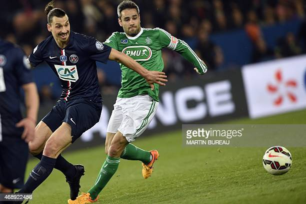 Paris SaintGermain's Swedish forward Zlatan Ibrahimovic fights for the ball with SaintEtienne's French defender Loic Perrin on April 8 2015 during a...