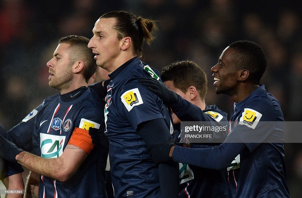 Paris Saint-Germain's Swedish forward Zlatan Ibrahimovic (C) is congratulated by teammates after scoring during the French Cup football match Paris Saint-Germain (PSG) vs Olympique de Marseille (OM) on February 27, 2013 at the Parc-des-Princes stadium in Paris.