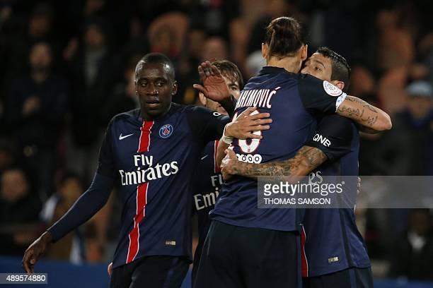 Paris SaintGermain's Swedish forward Zlatan Ibrahimovic is congratulated by teammates after scoring a goal during the French L1 football match...