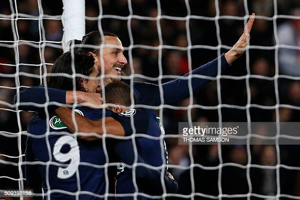 TOPSHOT Paris SaintGermain's Swedish forward Zlatan Ibrahimovic is congratulated by eammates after scoring a goal during the French Cup round of...