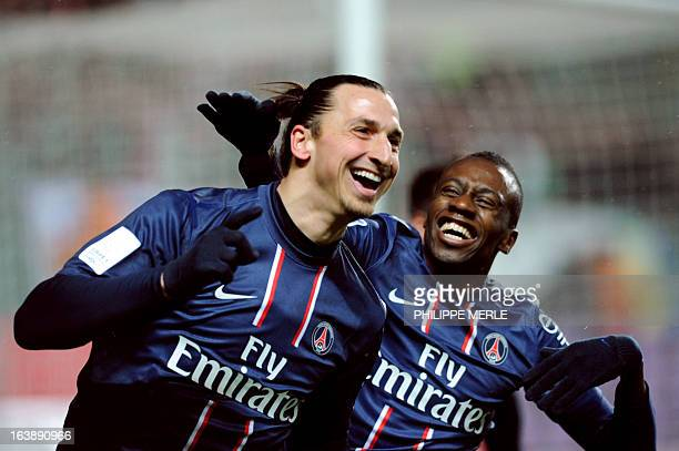 Paris SaintGermain's Swedish forward Zlatan Ibrahimovic is congratulated by his teammate French midfielder Blaise Matuidi after scoring a goal during...