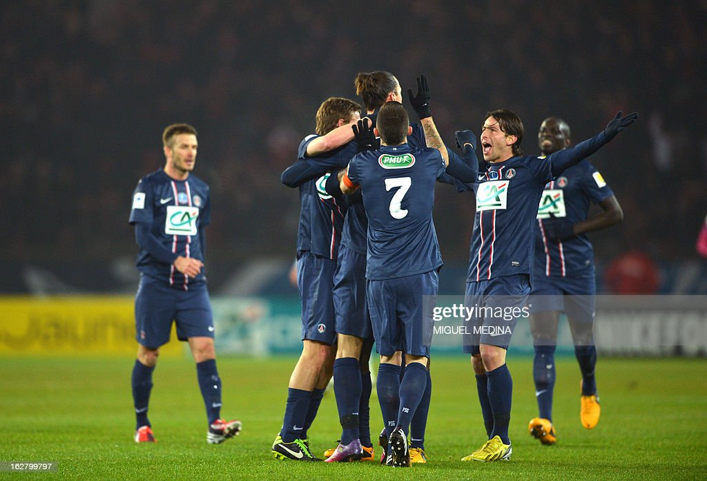 Paris Saint-Germain's Swedish forward Zlatan Ibrahimovic (C) is congratulated by Paris Saint-Germain's players after he scored a goal during the French Cup football match between Paris Saint Germain (PSG) vs Olympique de Marseille (OM) on February 27, 2013 at the Parc-des-Princes stadium in Paris.