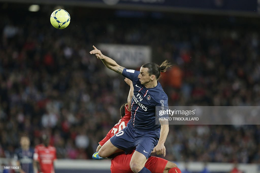 Paris Saint-Germain's Swedish forward Zlatan Ibrahimovic (R) jumps for the ball with Valenciennes' French defender Lindsay Rose during the French L1 football match Paris Saint-Germain vs Valenciennes at the Parc des Prince in Paris on May 5, 2013.