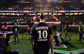 TOPSHOT Paris SaintGermain's Swedish forward Zlatan Ibrahimovic leaves a pitch with a trophy after winning the French L1 title at the end of the...