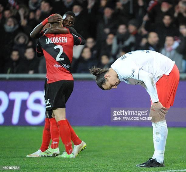 Paris SaintGermain's Swedish forward Zlatan Ibrahimovic looks at his legs after the French L1 football match between EA Guingamp and Paris...