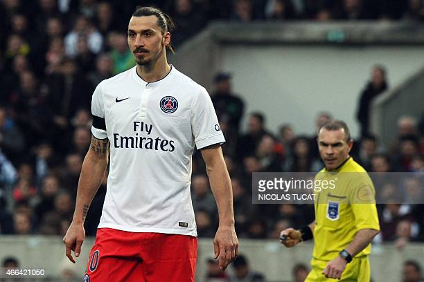 Paris SaintGermain's Swedish forward Zlatan Ibrahimovic looks on with French referee Lionel Jaffredo in the background during the French L1 football...