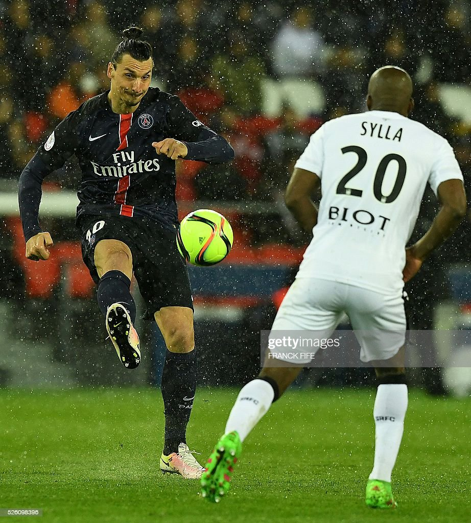 Paris Saint-Germain's Swedish forward Zlatan Ibrahimovic (L) passes the ball in front Rennes' Malian midfielder Yacouba Sylla during the French L1 football match between Paris Saint-Germain and Rennes at the Parc des Princes stadium in Paris on April 30, 2016. / AFP / FRANCK