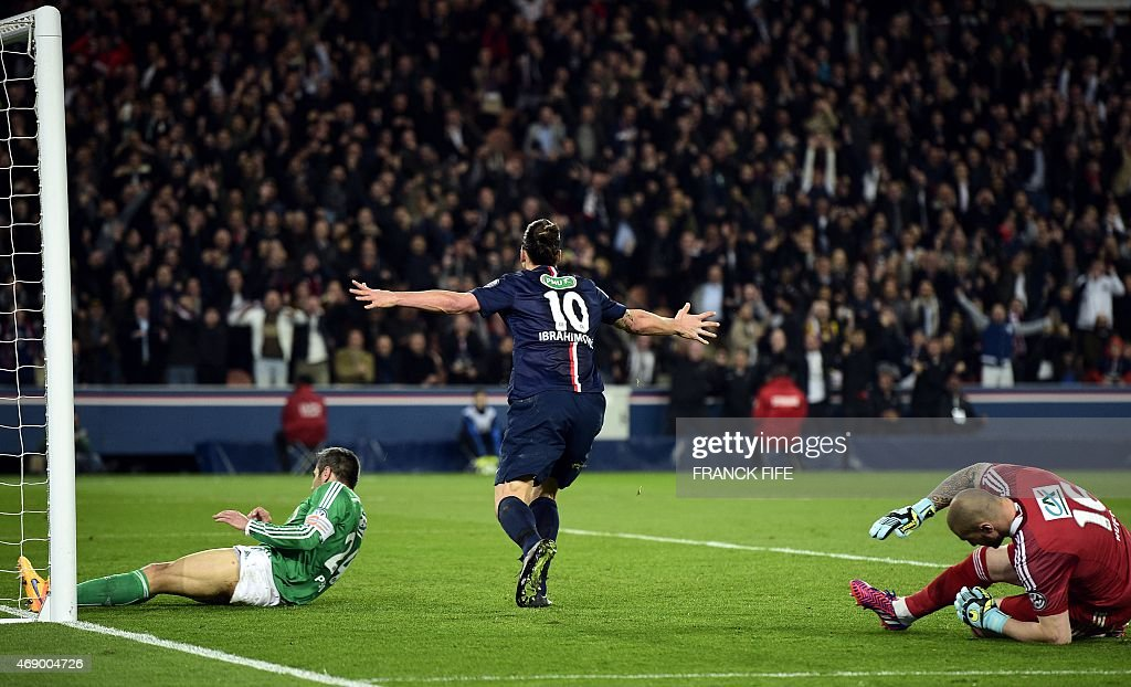 Paris Saint-Germain's Swedish forward <a gi-track='captionPersonalityLinkClicked' href=/galleries/search?phrase=Zlatan+Ibrahimovic&family=editorial&specificpeople=206139 ng-click='$event.stopPropagation()'>Zlatan Ibrahimovic</a> (C) reacts after his goal next to St Etienne's French goalkeeper <a gi-track='captionPersonalityLinkClicked' href=/galleries/search?phrase=Stephane+Ruffier&family=editorial&specificpeople=4978820 ng-click='$event.stopPropagation()'>Stephane Ruffier</a> (R) during the French Cup semi-final match between Paris Saint-Germain (PSG) and Saint-Etienne (ASSE) on April 8, 2015 at the Parc des Princes stadium in Paris. PSG won 4-1.