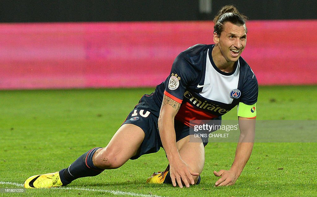 Paris Saint-Germain's Swedish forward <a gi-track='captionPersonalityLinkClicked' href=/galleries/search?phrase=Zlatan+Ibrahimovic&family=editorial&specificpeople=206139 ng-click='$event.stopPropagation()'>Zlatan Ibrahimovic</a> reacts during a French L1 football match between Valenciennes and Paris Saint-Germain on September 25, 2013 at the Stade du Hainaut in Valenciennes, northern France.