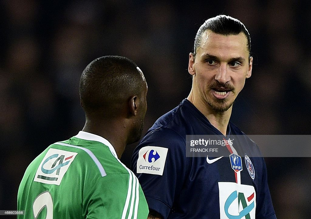 Paris Saint-Germain's Swedish forward <a gi-track='captionPersonalityLinkClicked' href=/galleries/search?phrase=Zlatan+Ibrahimovic&family=editorial&specificpeople=206139 ng-click='$event.stopPropagation()'>Zlatan Ibrahimovic</a> (R) reacts to St Etienne's French defender Kevin Theophile-Catherine during the French Cup semi-final football match Paris Saint-Germain (PSG) vs Saint-Etienne (ASSE) on April 8, 2015 at the Parc des Princes stadium in Paris.