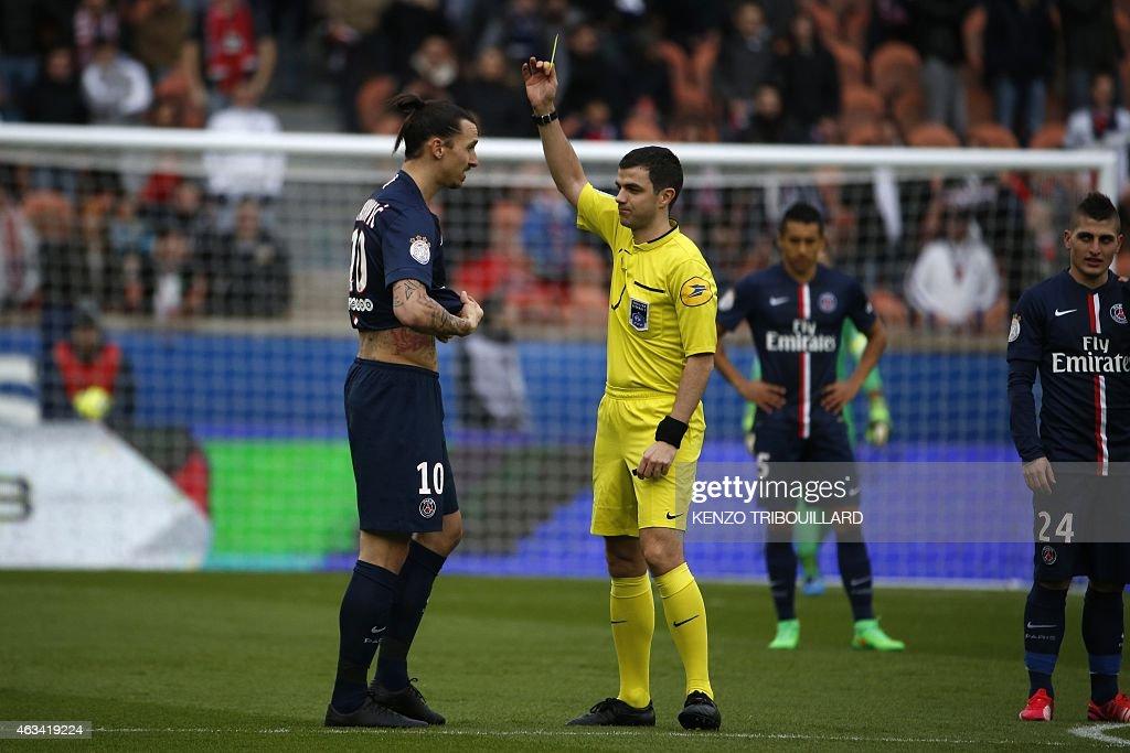 Paris SaintGermain's Swedish forward Zlatan Ibrahimovic receives a yellow card after taking off his shirt during the French L1 football match Paris...